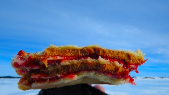 Our daily bread and butter! AND peanut butter AND jelly. This is two sandwiches frozen together that we broke in half to share. A pure caloric bomb that can only be improved by being fried in bacon fat. Pictured is 4 pieces of squashed white bread, lots of butter, peanut butter and jelly to taste. We would go on another expedition just to eat these things. Seriously.